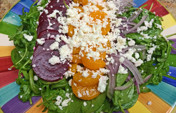 Salad with Beets, lettuce, mandarin oranges, red onions, and goat cheese.