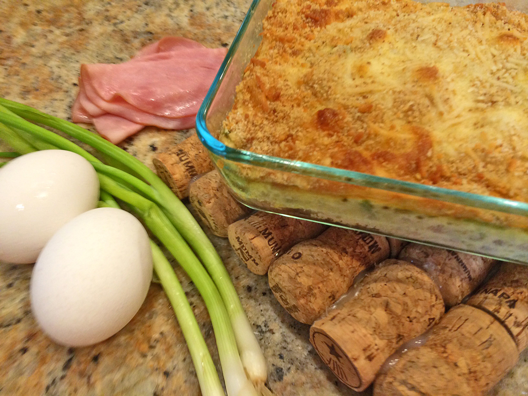 Chicken cordon bleu bake with eggs, ham, and green onions.