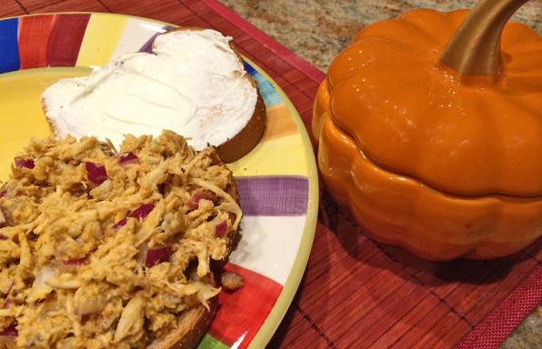 Pumpkin and walnut chicken salad sandwich with cream cheese.