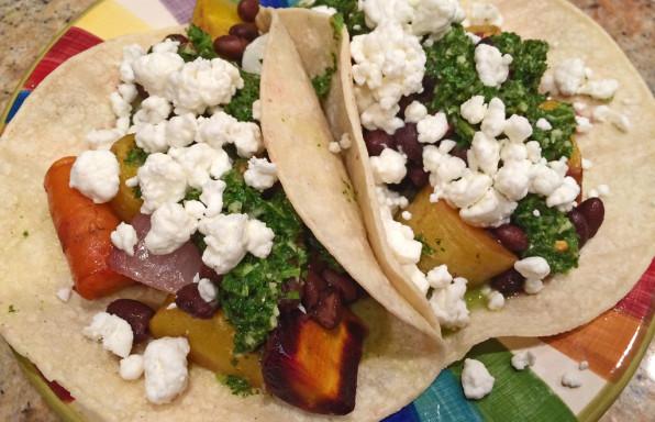Black bean tacos with rainbow carrots and chimichurri sauce.