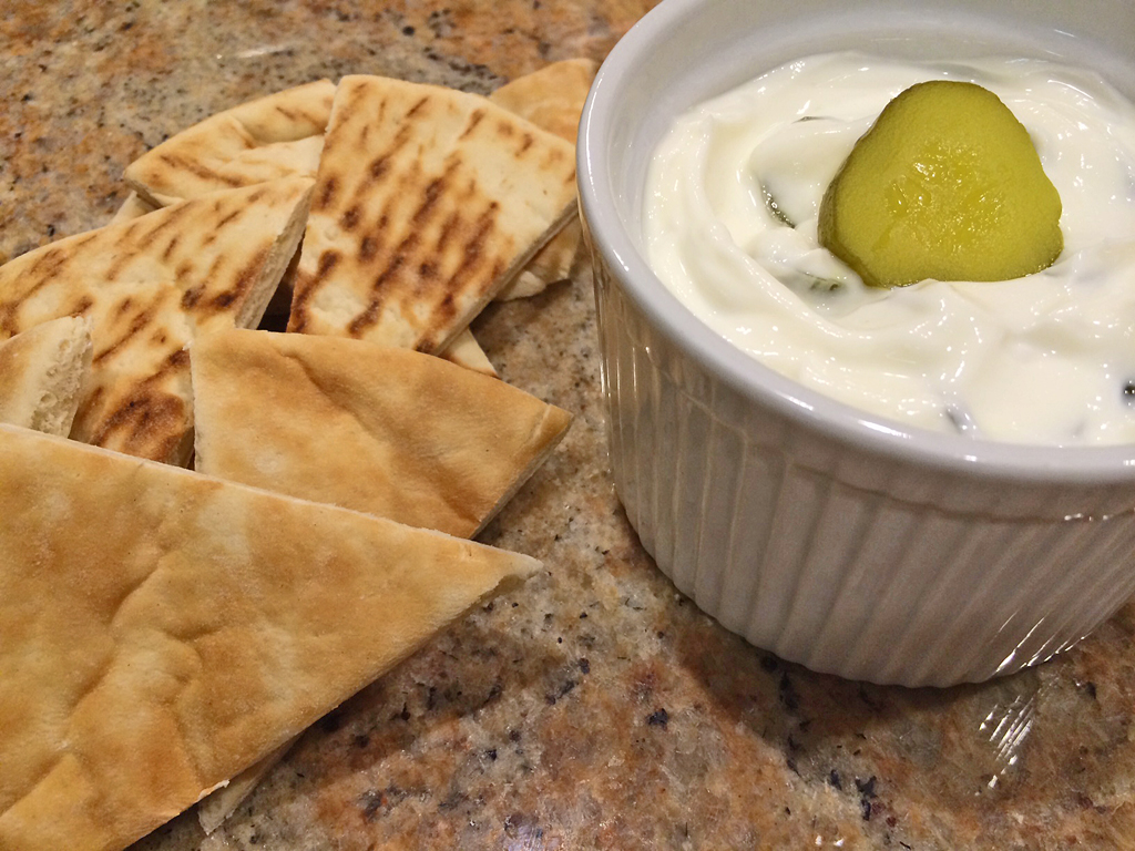 Cucumber Tzatziki made with pickles and greek yogurt with pita bread.