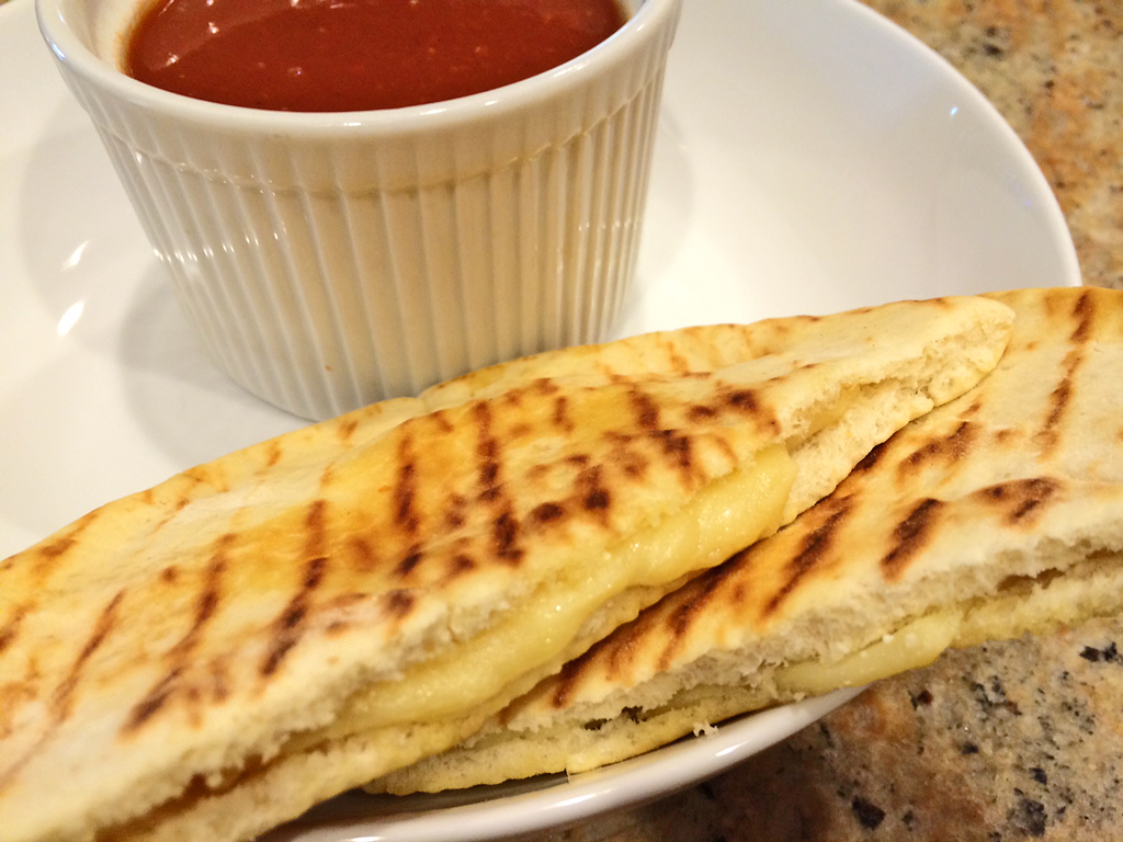 Pocket Bread Grilled Cheese with pita, cheese, and tomato soup.