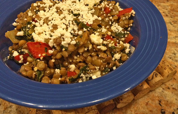 Lentil casserole with goat cheese, tomatoes, and spinach.