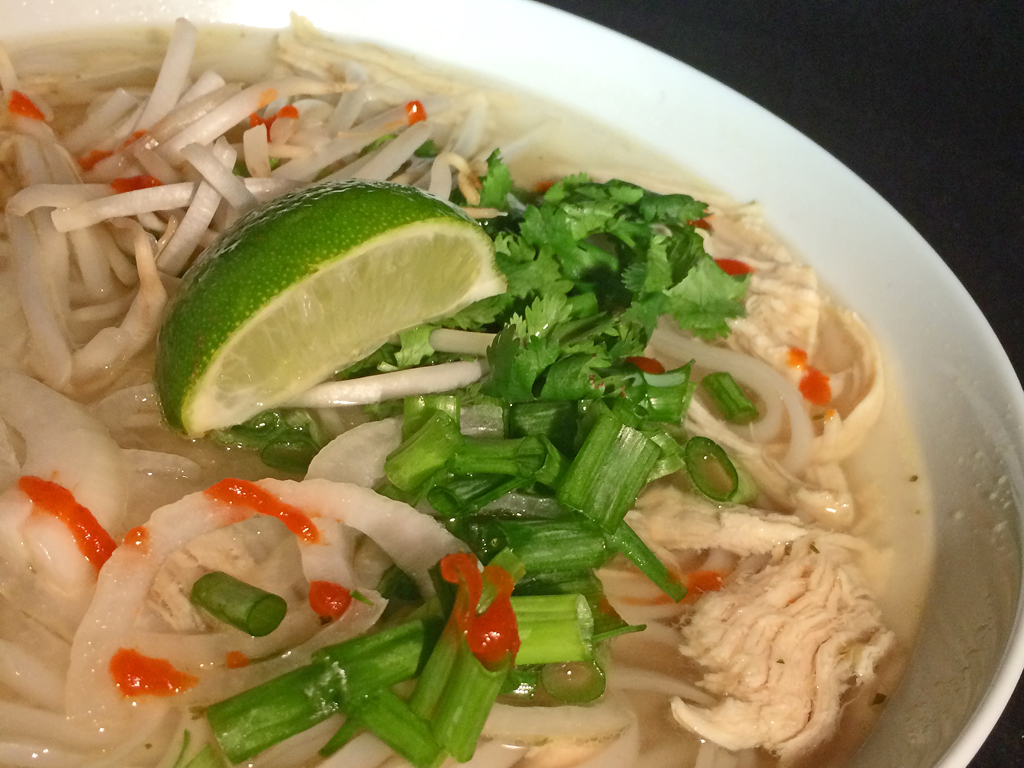 Easy Pho Ga with chicken, green onions, and lime.
